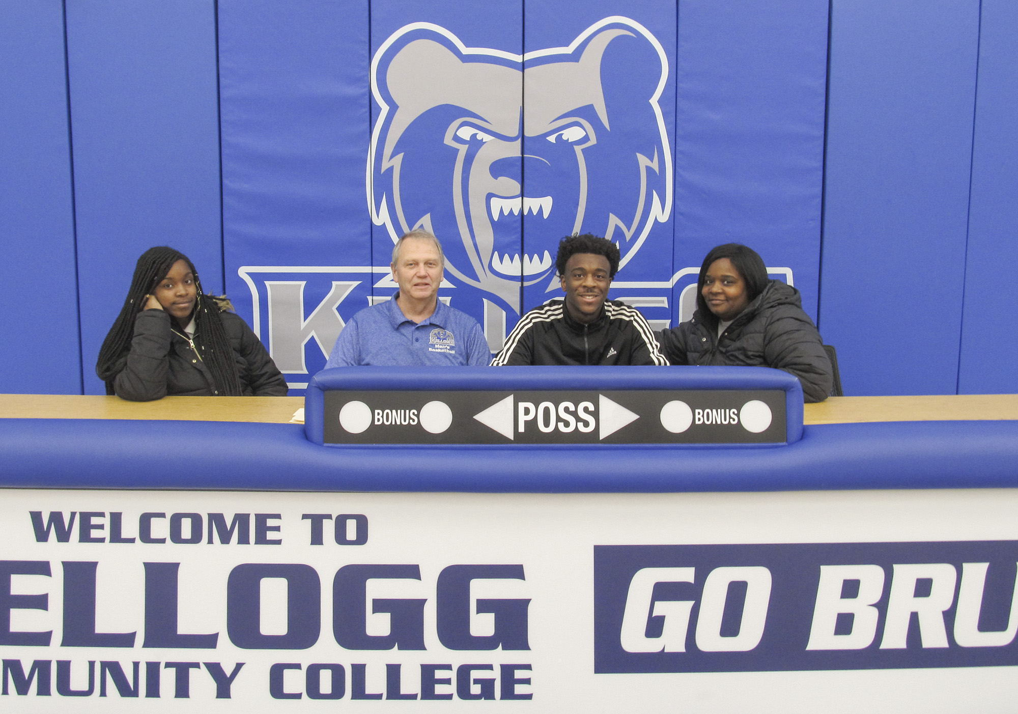 Pictured, from left to right, are Asya Wesley (sister), KCC's Head Men's Basketball Coach Gary Sprague, Eddie Wesley and Ardra Wesley (mother).