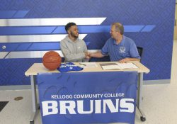 Pictured, from left to right, are Jamari Newell and KCC's Head Men's Basketball Coach Gary Sprague.