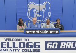 Pictured, from left to right, are Micah Mcree-Davis (cousin), KCC's Head Men's Basketball Coach Gary Sprague, Karlos Berry and Tavion Kelley (brother).
