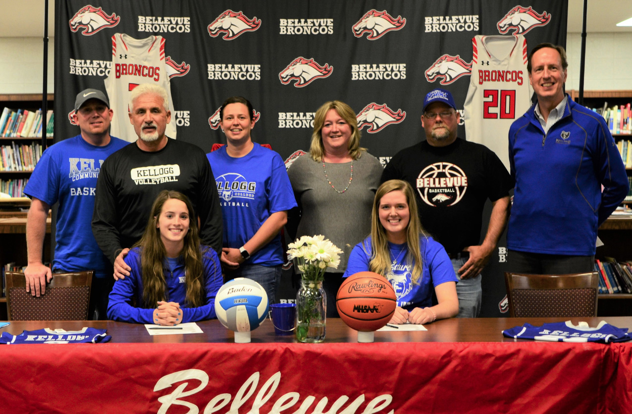 Pictured, in the front row, from left to right, are Gabby Costello and Modaina Angus. In the back row, from left to right, are Bellevue High School's Assistant Girls Basketball Coach Jason Whitcomb, Joe Costello (father), Bellevue High School's Head Girls Basketball Coach Kayla Whitmyer, Tandra Angus (mother), Mark Angus (father) and KCC's Head Women's Basketball Coach Dic Doumanian.