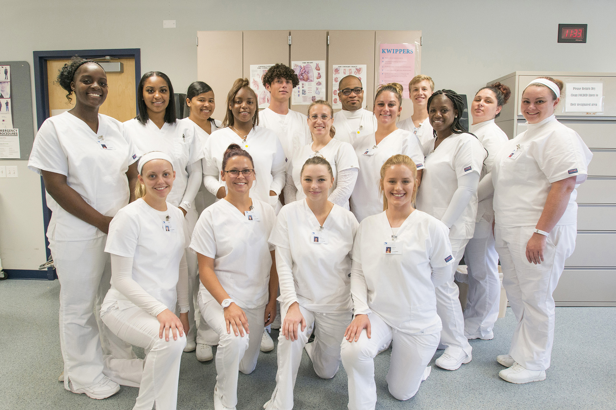 A group photo of CNA Program graduates posing in the CNA Lab.