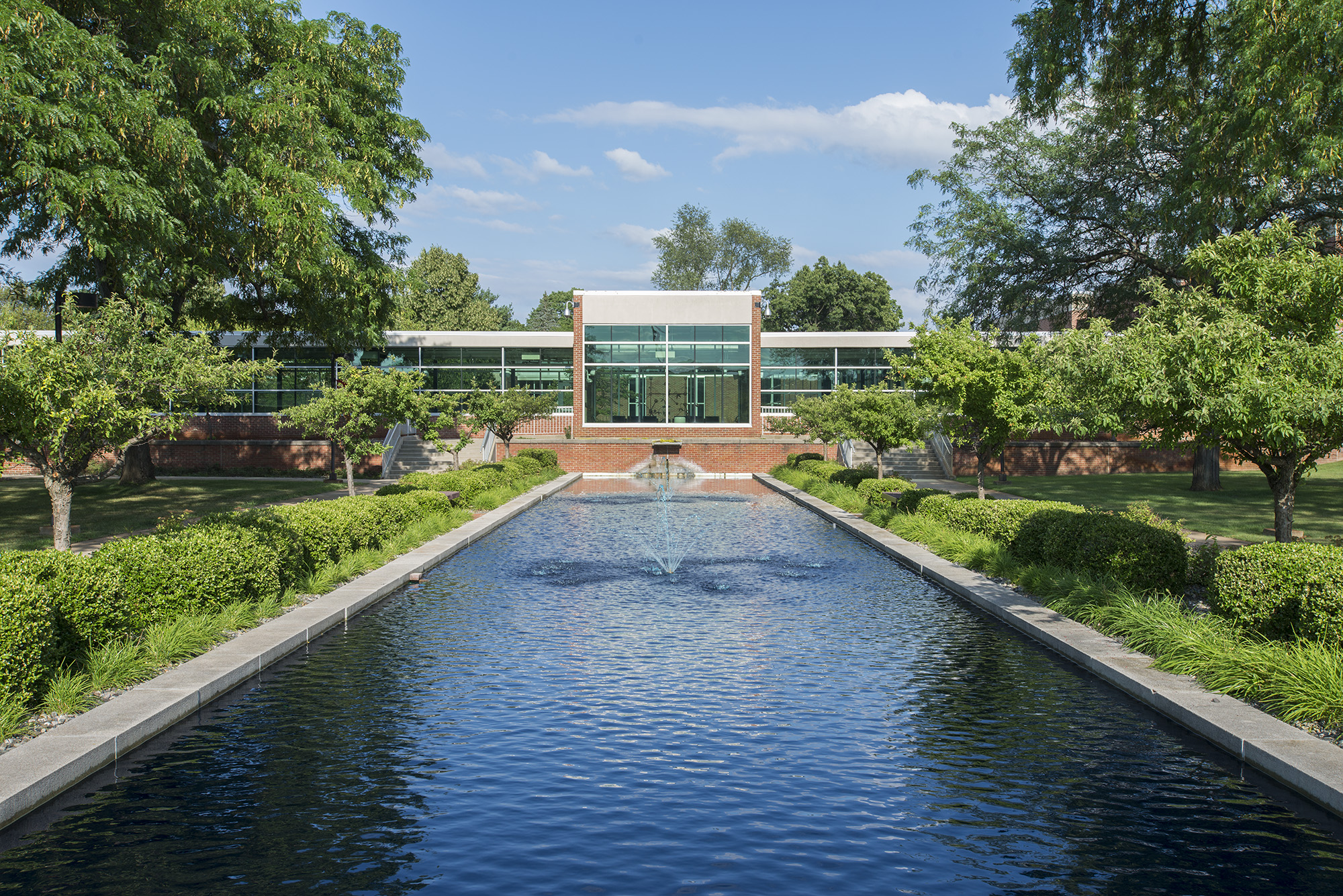 An exterior view of the entrance to KCC's North Avenue campus looking over the reflecting pools.