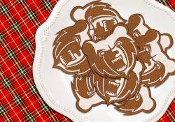 Holiday cookies shaped like KCC's Bruin head logo, on a plate.