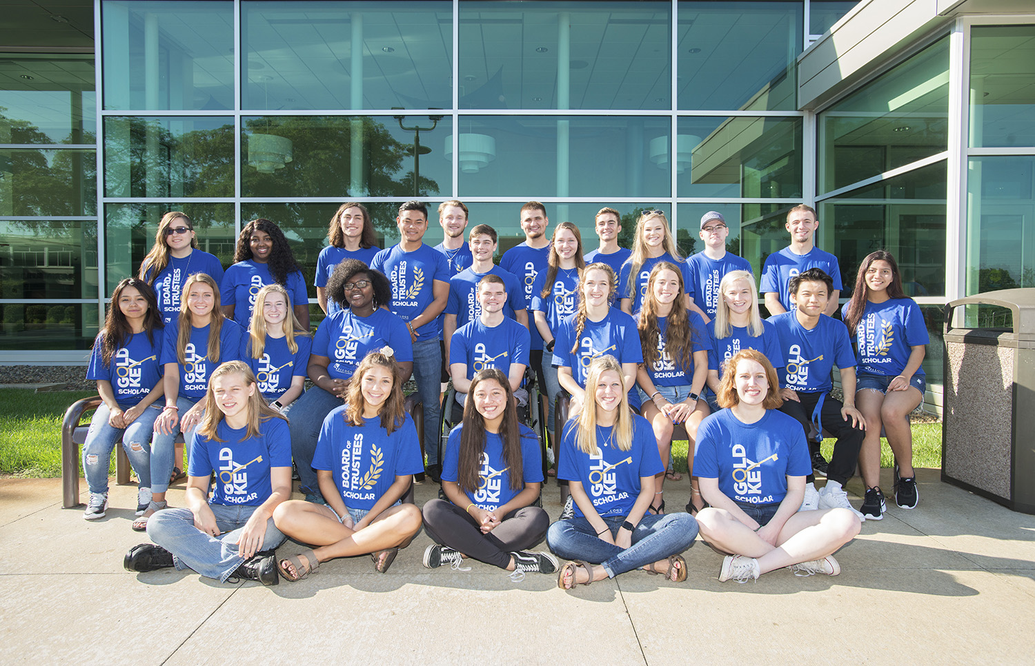 A group photo of KCC's 2019-20 honor students posing outside the Binda Performing Arts Center.