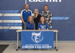 In the front row, from left to right, are Head KCC Cross-Country Coach Erin Lane and Kennedy VanderLugt. In the back row, from left to right, are Plainwell High School Girls Cross-Country Coach Brett Beier, Jeanna VanderLugt (mother) and Ben VanderLugt (father).