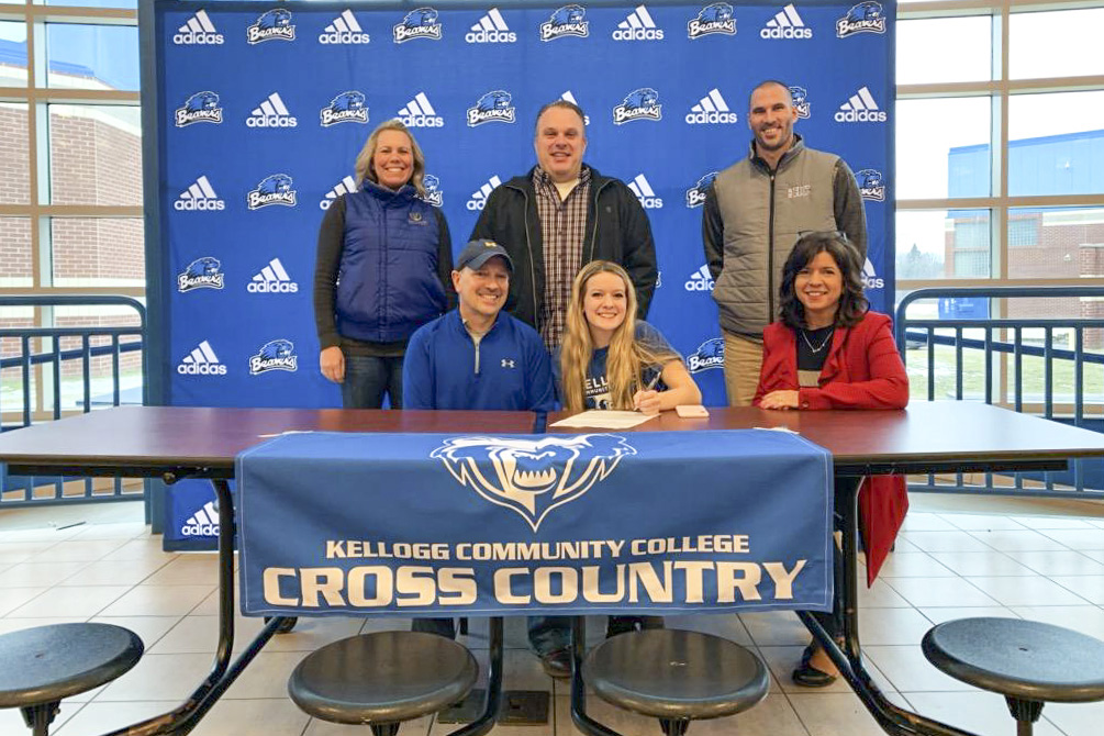 In the front row, from left to right, are Ken Sult (father), Lizzie Sult and Cindy Andrews (mother). In the back row, from left to right, are Head KCC Cross-Country Coach Erin Lane, Eric Andrews (stepfather) and Harper Creek High School's Head Cross-Country Coach Ryan Renner.