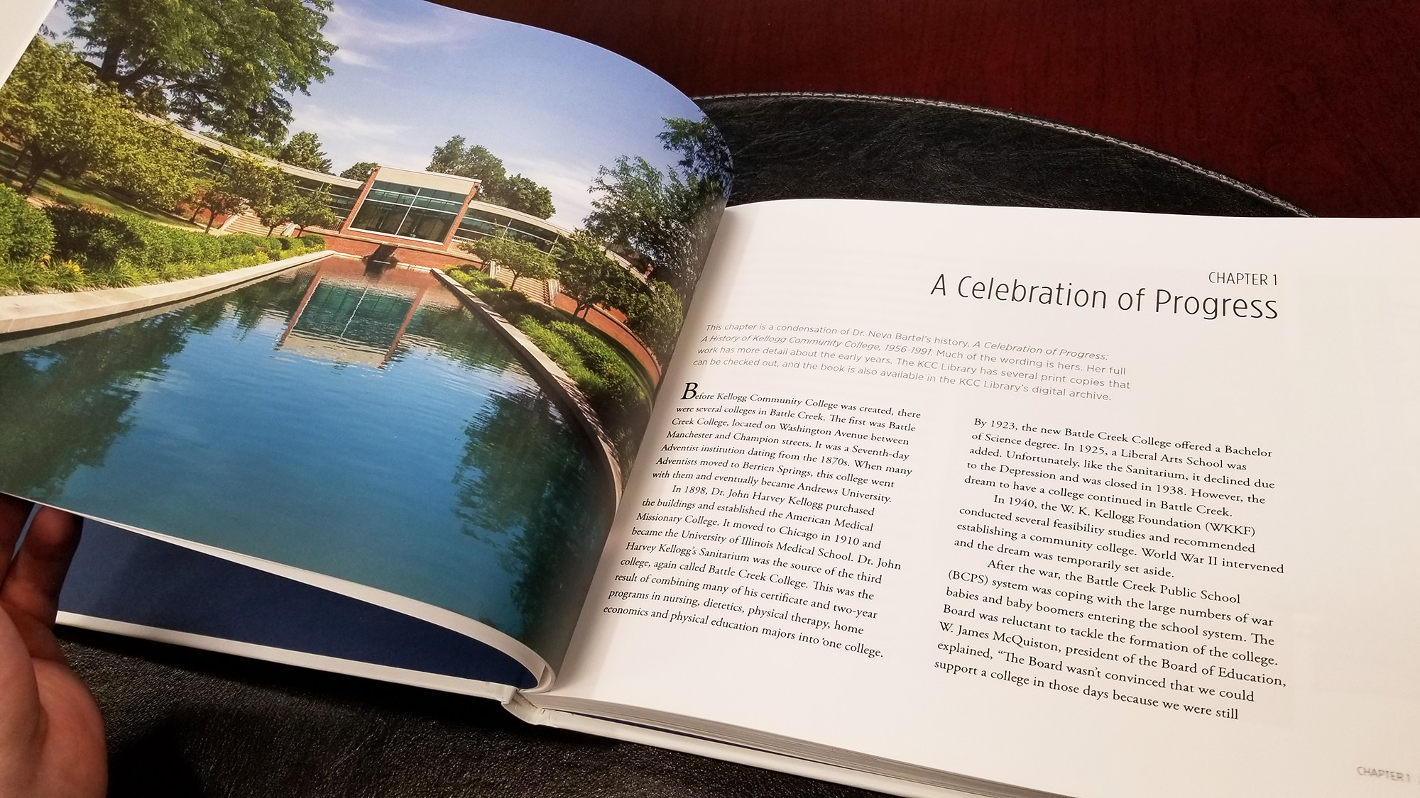 "A decorative image showing an interior spread of the book ""Always a Bruin,"" including a full page photo of the reflecting pools on the North Avenue campus."