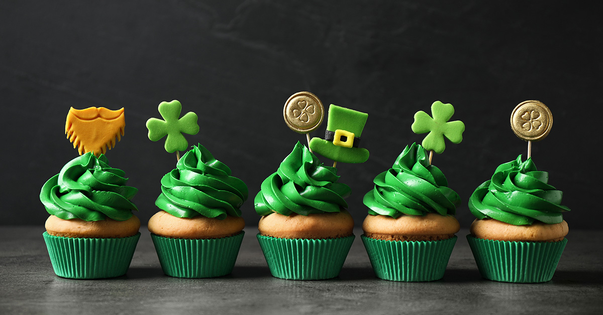 Cupcakes with green frosting decorated for St. Patrick's Day