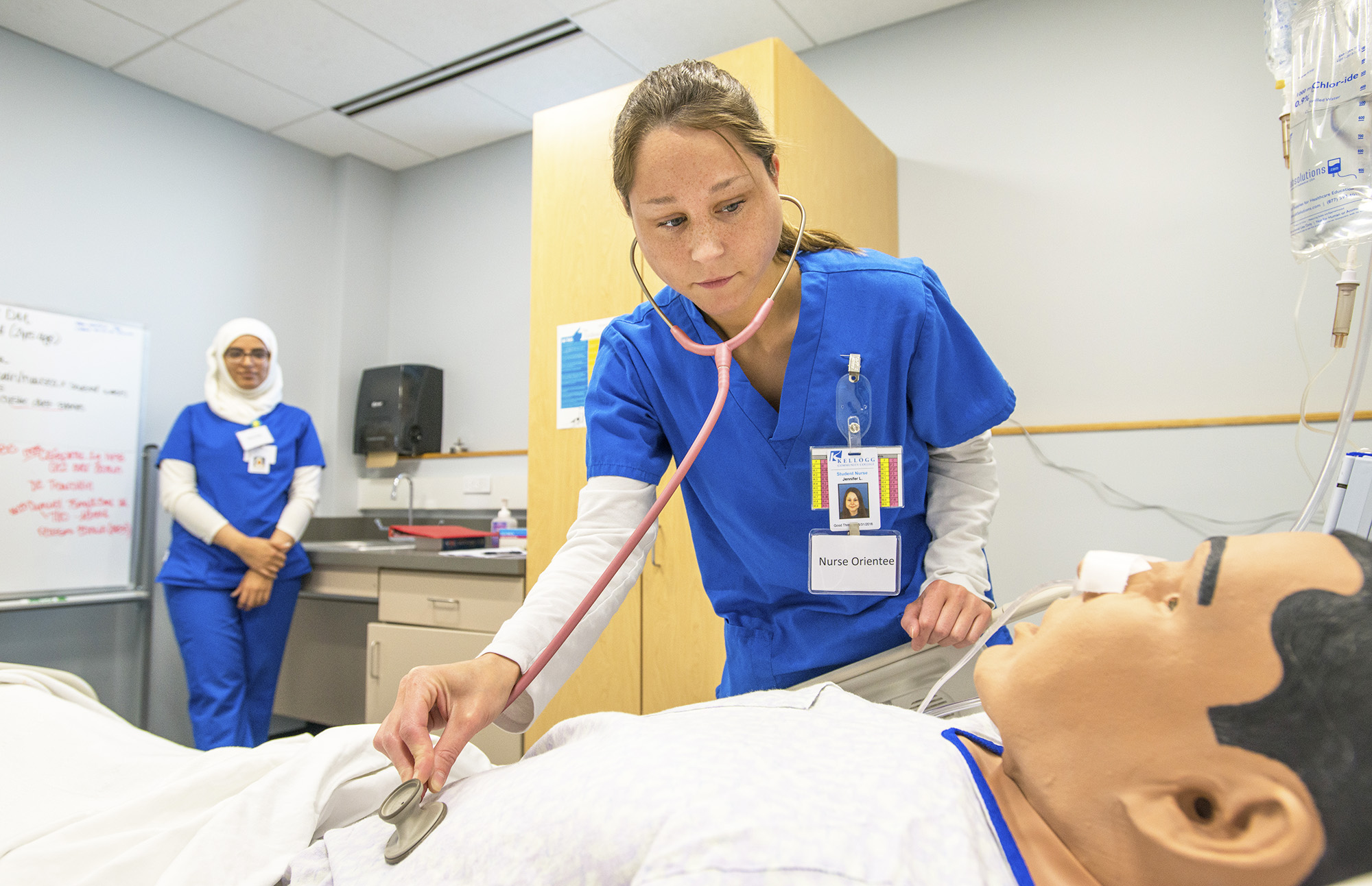 KCC Nursing students work with a patient simulator in a Nursing Lab on campus.