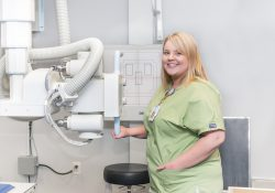 A Radiography Program student poses in the Radiography Lab.