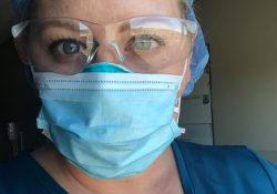 Nursing student Rachel Rewa wearing safety glasses and a facemask.