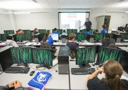 Students listen to an instructor in a KCC computer lab.