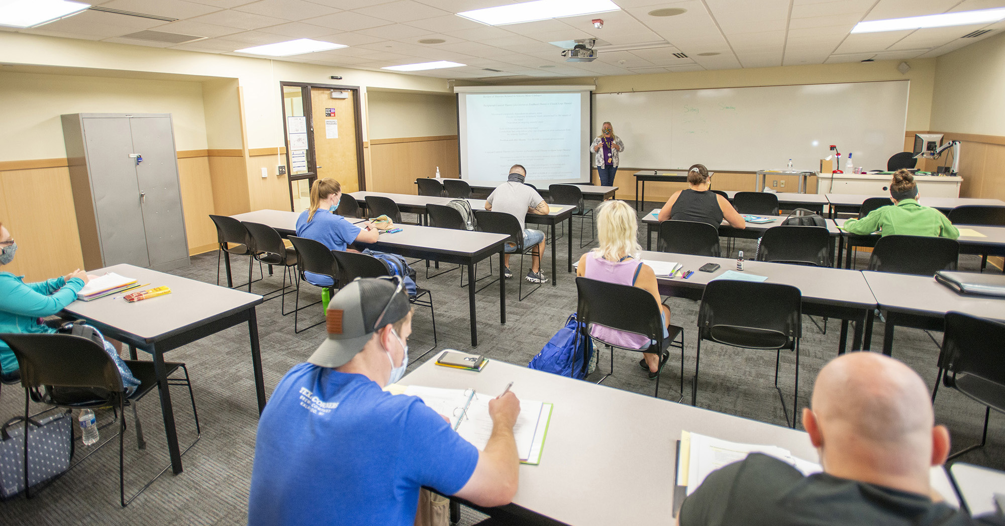Students listen to an instructor during class.