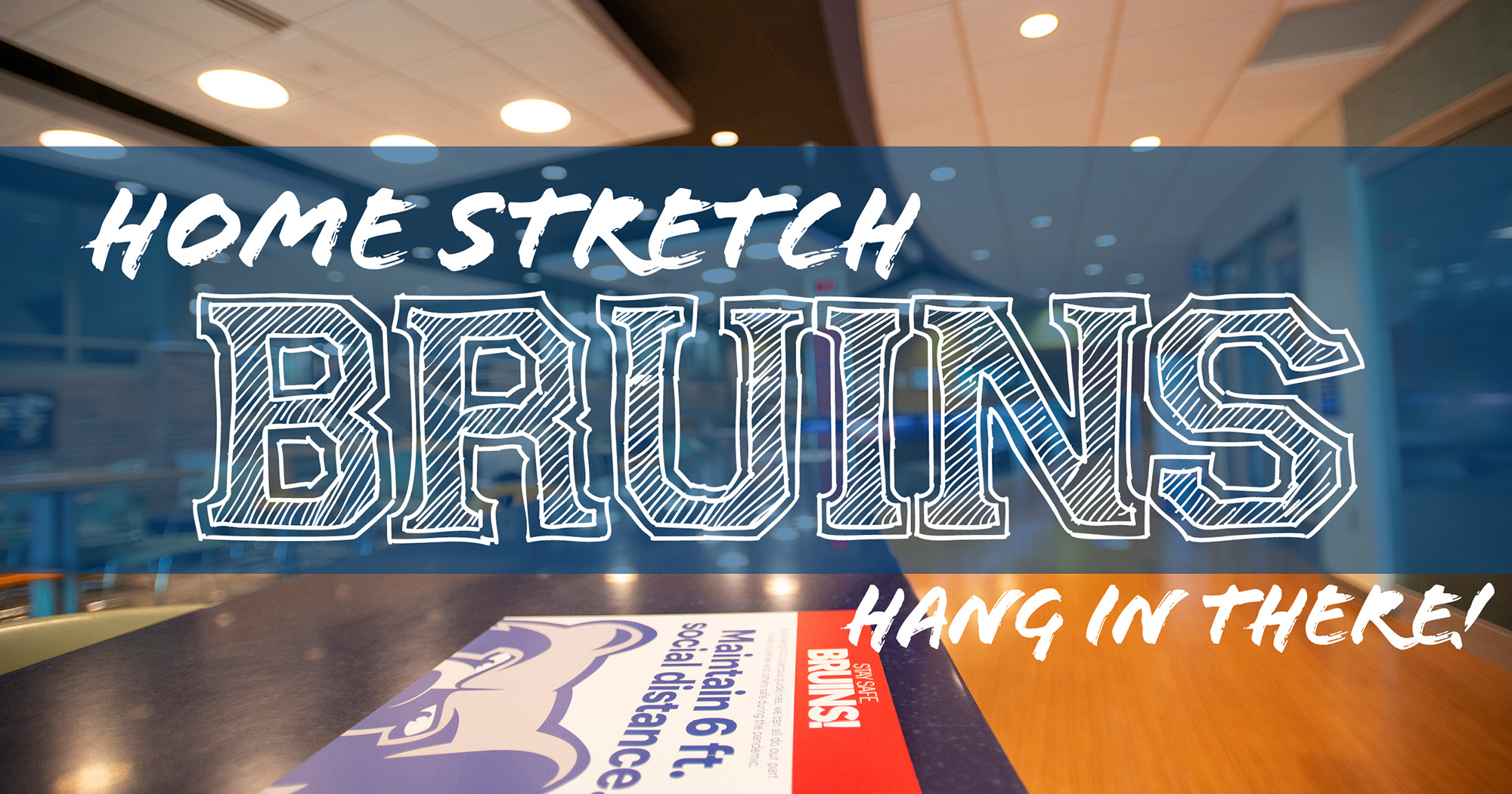 """The Student Center with a text overlay that reads """"Home Stretch Bruins. Hang in there!"""""""