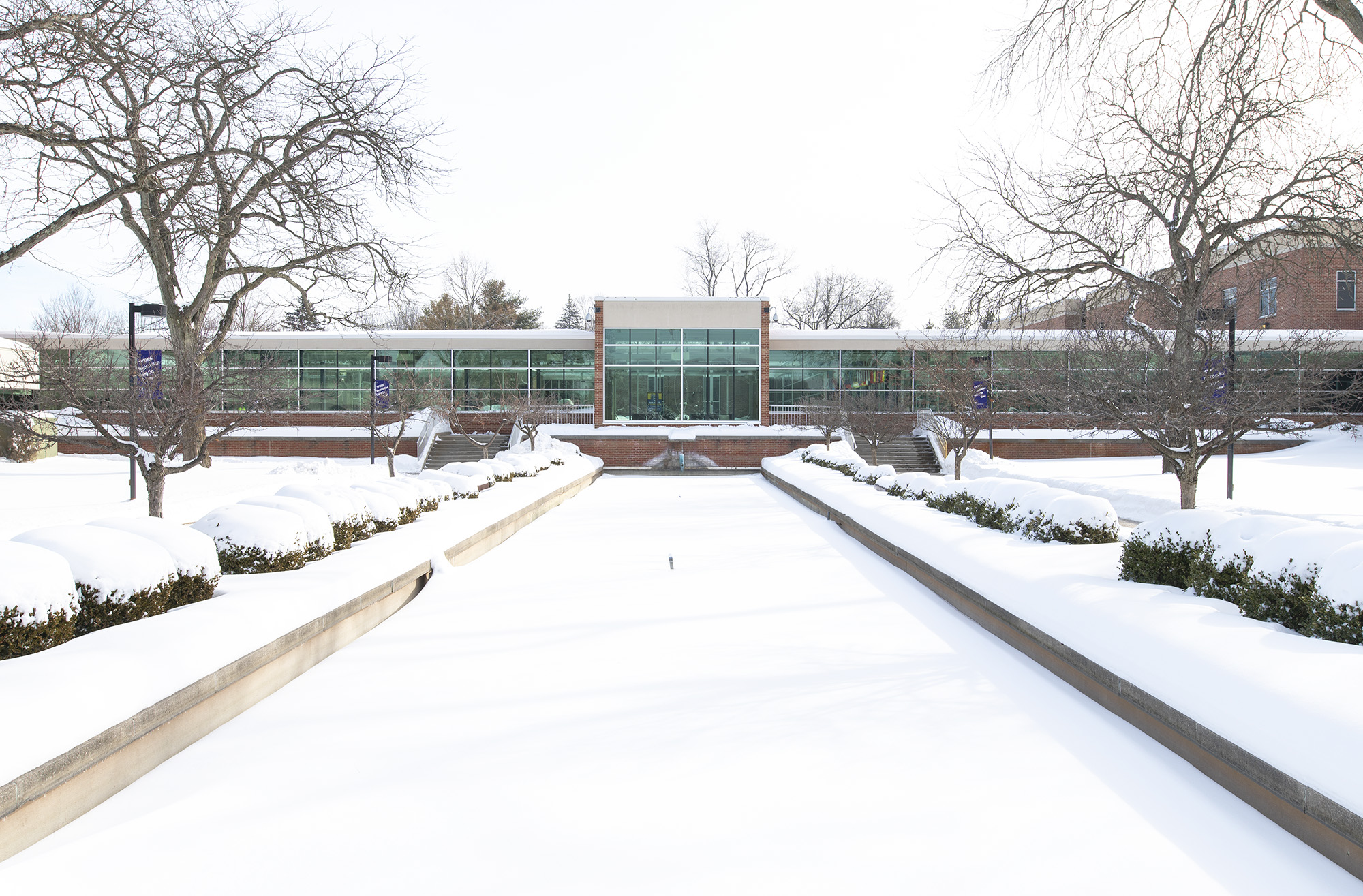 Snow blankets the reflecting pools at the entrance to KCC's North Avenue campus in Battle Creek.