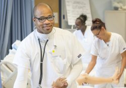 CNA students work with patients in a CNA Lab.