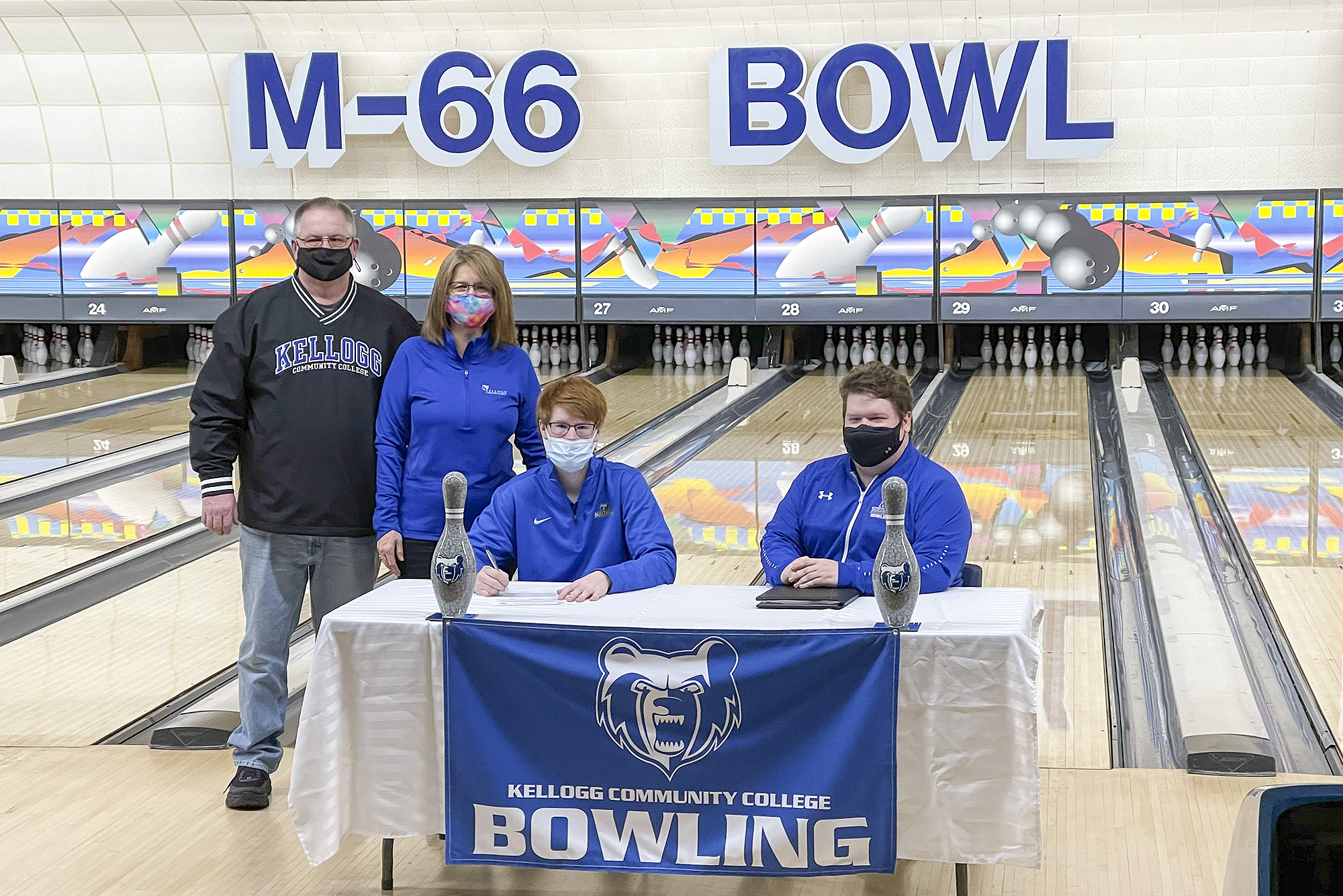 Pictured, from left to right, are Zach Beard (father), Cheryl Beard (mother), Cody Beard and Head KCC Bowling Coach Brad Morgan.