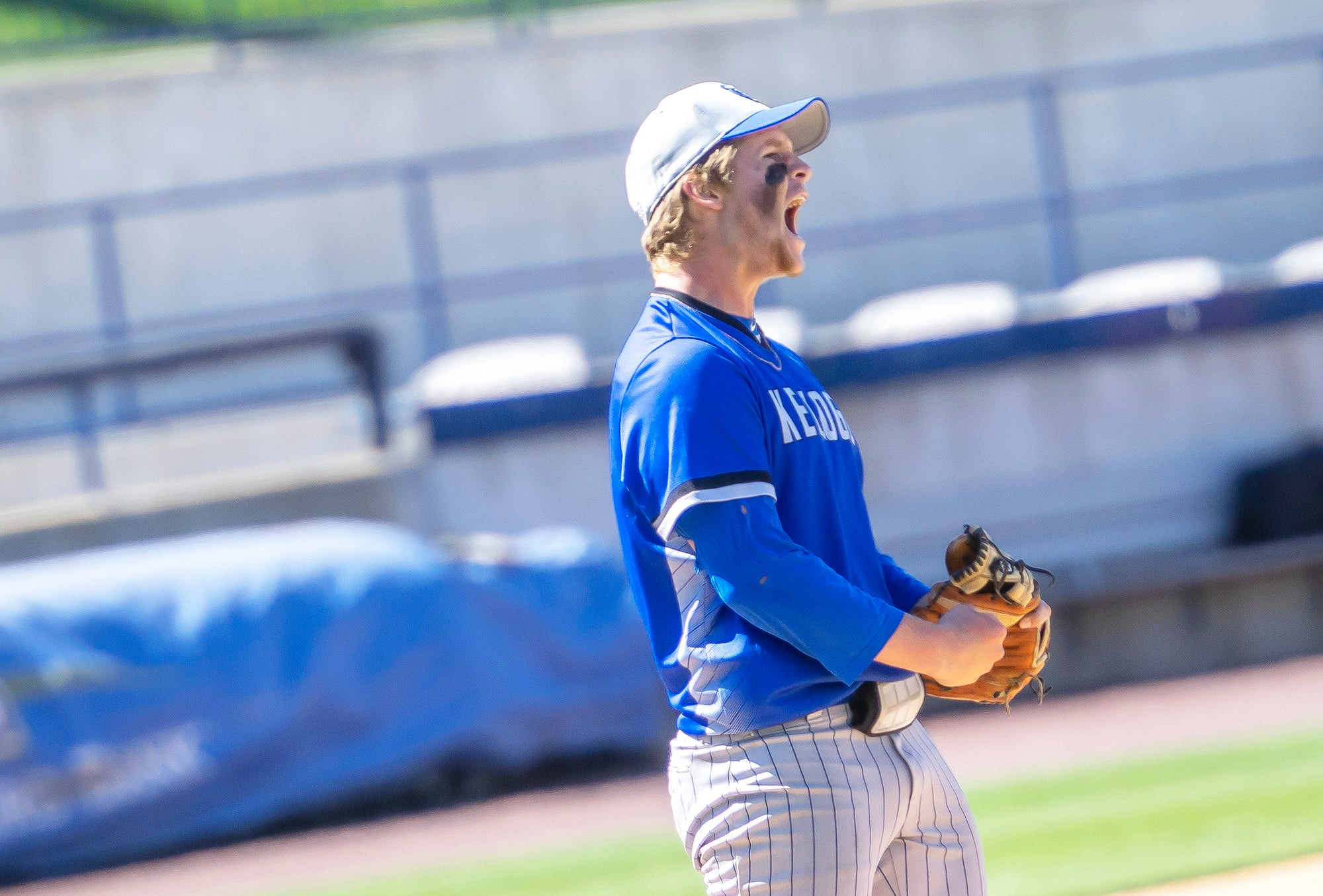 Pitcher Jayden Dentler shouts from the mound after striking out a batter.