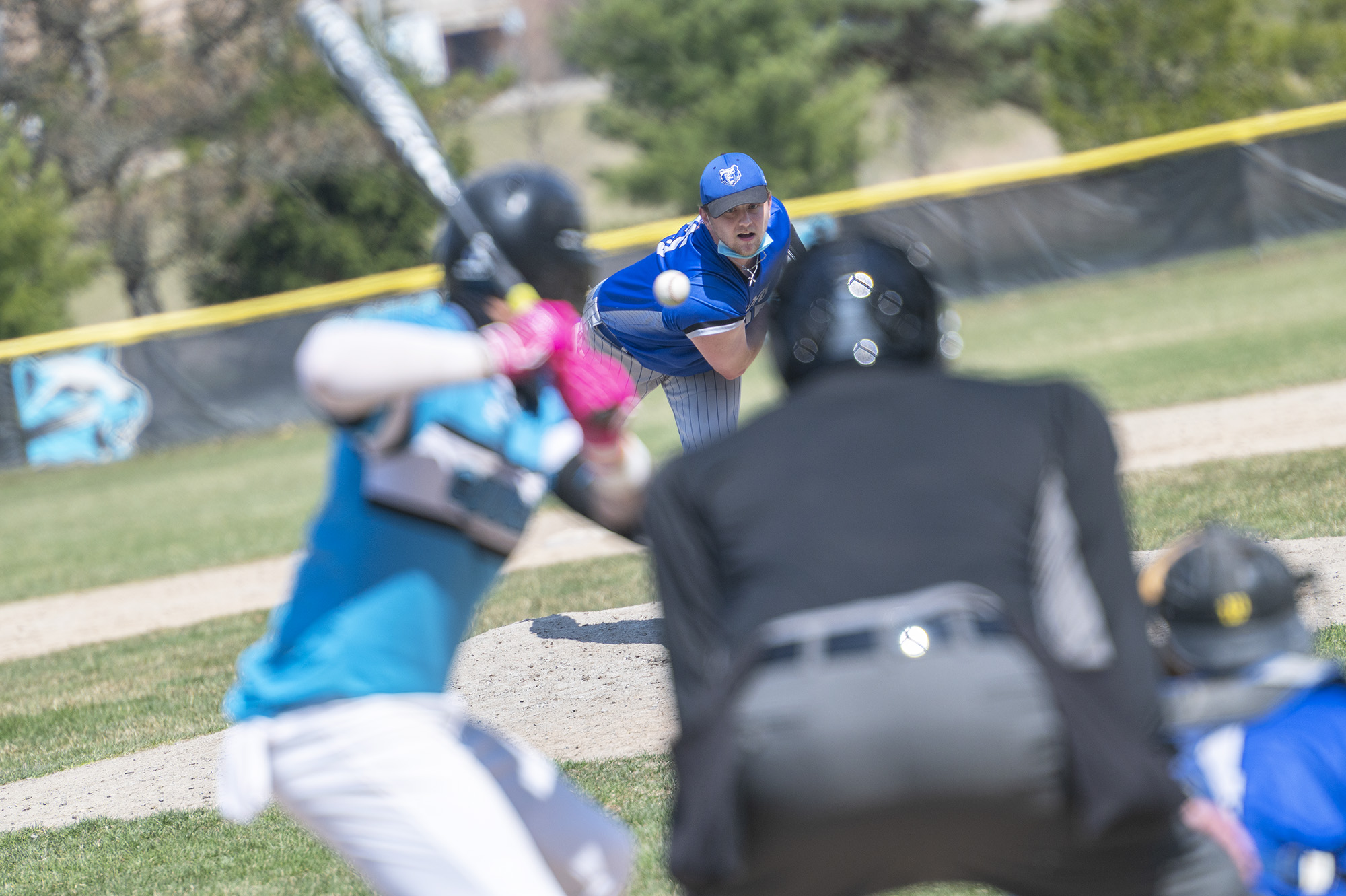 A KCC pitcher pitches to a batter.
