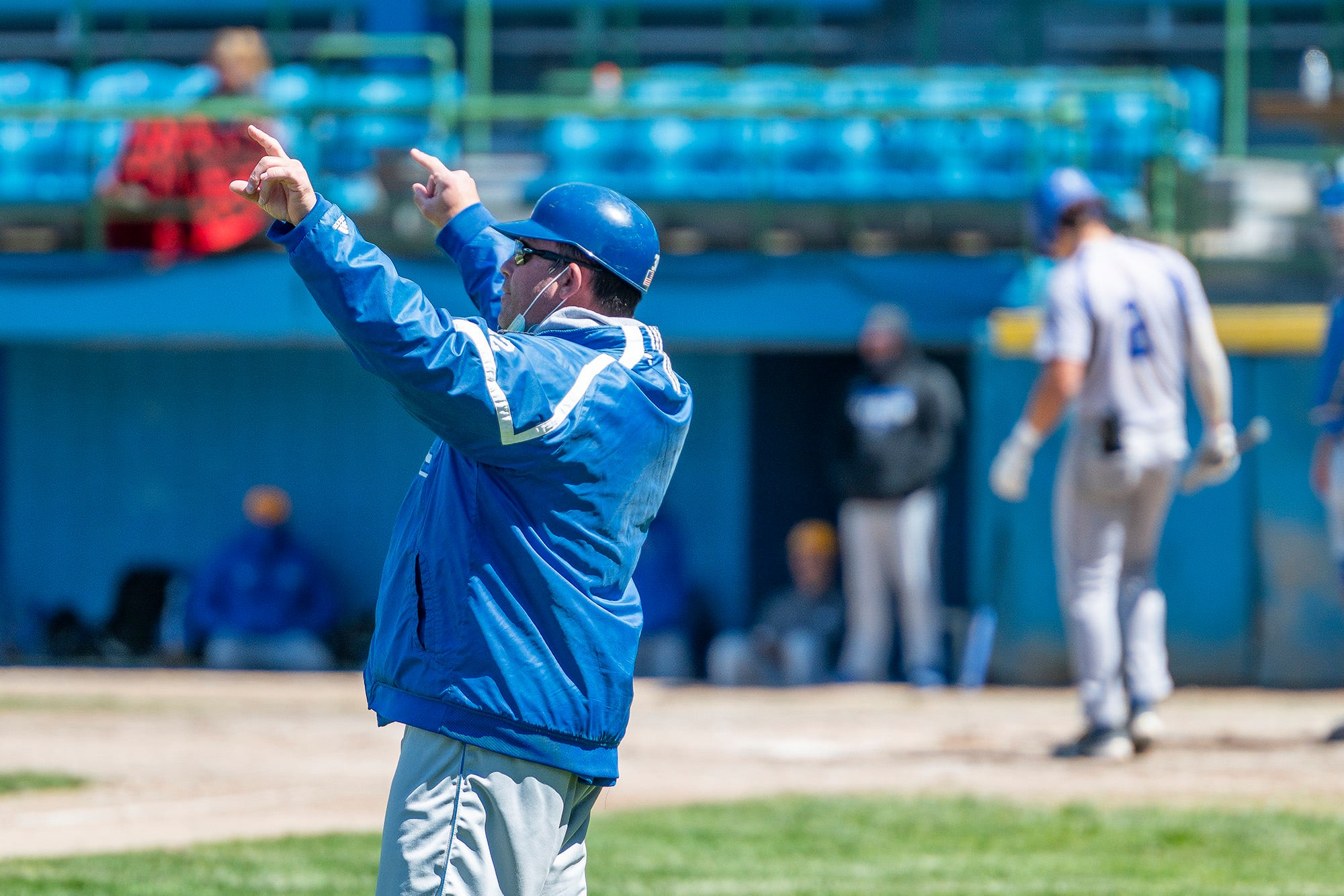 KCC Baseball Coach Eric Laskovy holds his hands up during a game.