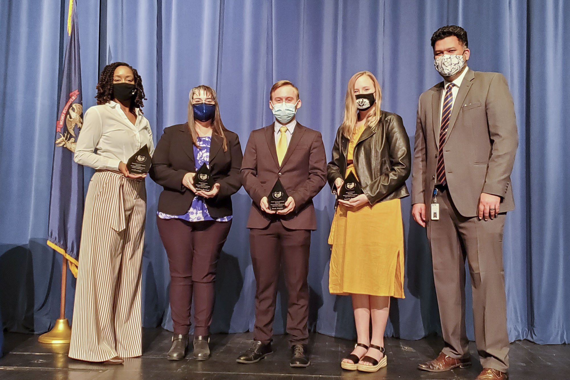 The 2021 Outstanding Division Graduates accept their awards. From left to right are Dr. Adrien Bennings, president of KCC; Gaylene Rowland; Jacob Janofski; Isabella Proulx; and Dr. Paul Watson, vice president for Instruction at KCC. Not pictured are student award winners Robert Essex and Sarah Smith.