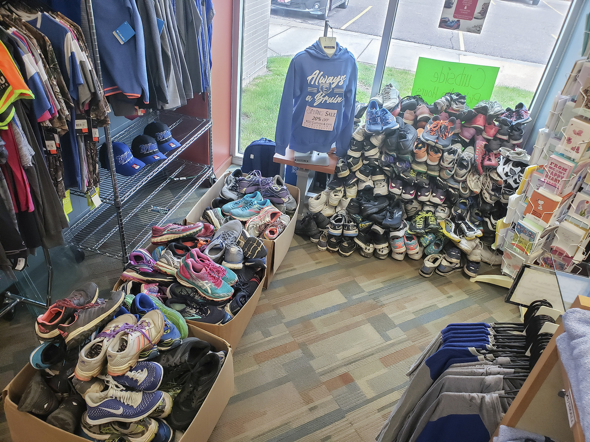 Used shoes in boxes collected as part of the Bruin Bookstore's annual Sneaker Collection.