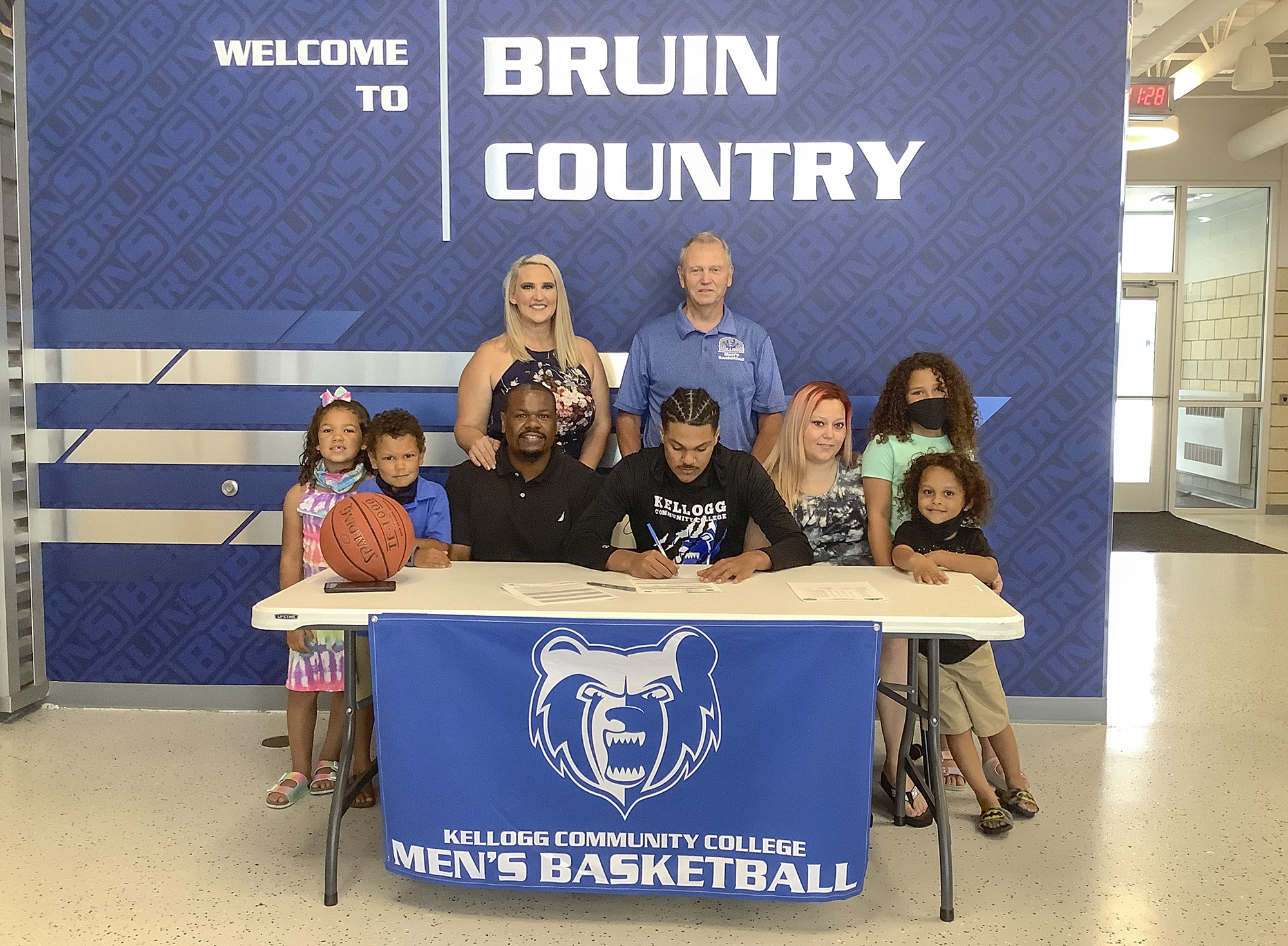 Keelan Stricklen signs his Letter of Intent at KCC while surrounded by family members.