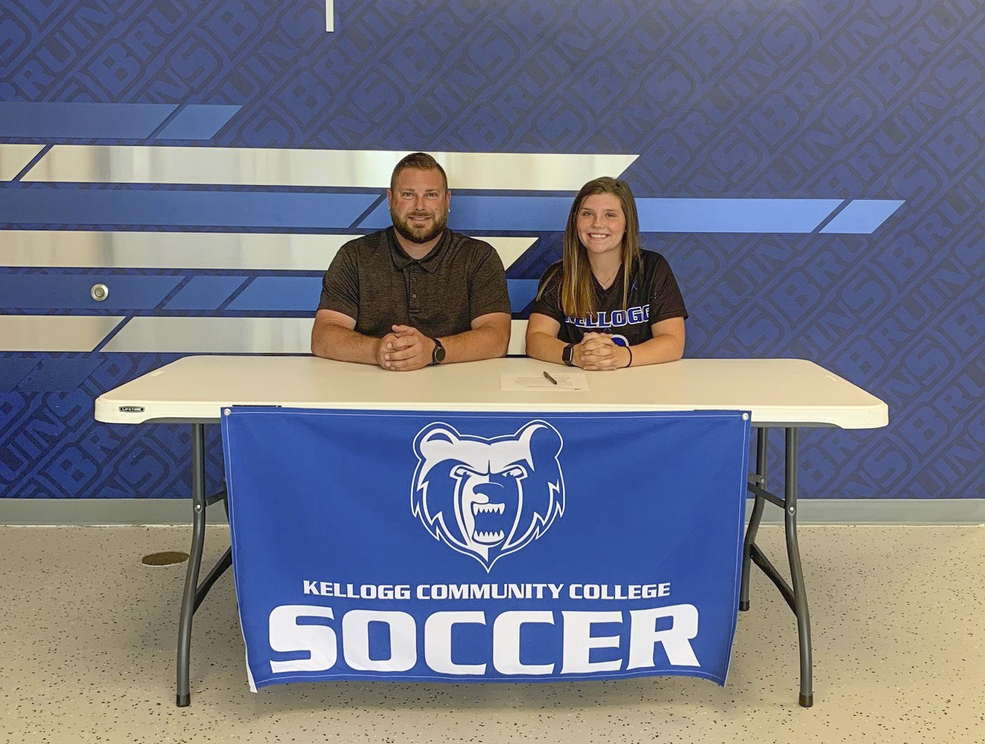 Pictured, from left to right, are Head KCC Women's Soccer Coach Levi Butcher and Chloe Leugers.