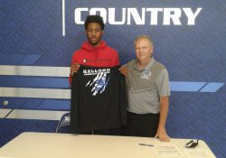 Pictured, from left to right, are Rasheed Dyson and KCC's Head Men's Basketball Coach Gary Sprague.