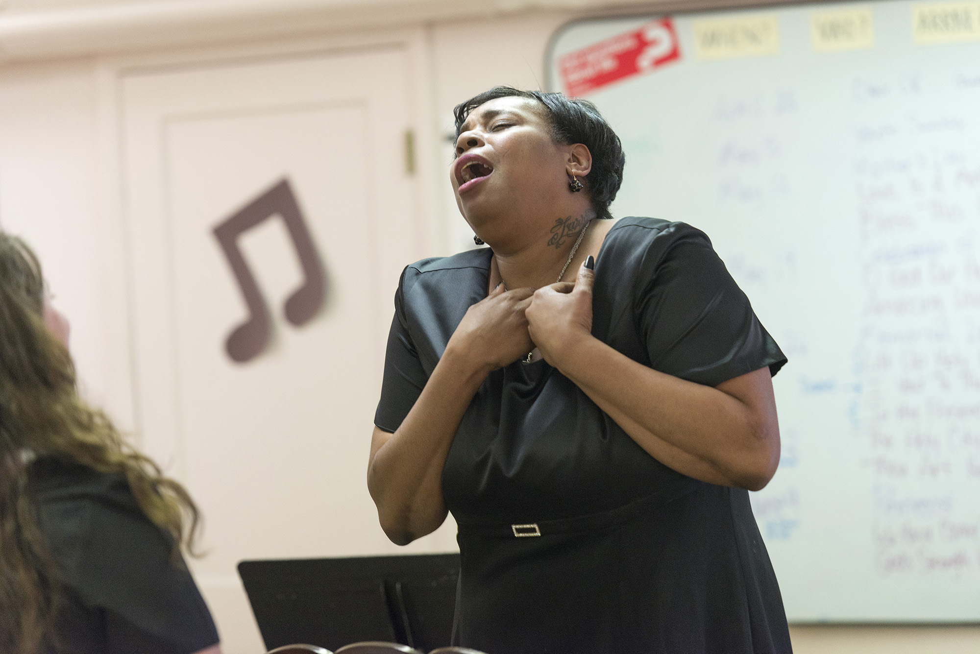 A woman singing.