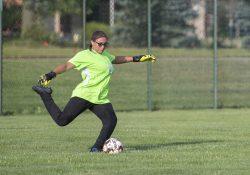 Goalkeeper Maya Ruelas kicks the ball during a home soccer game.