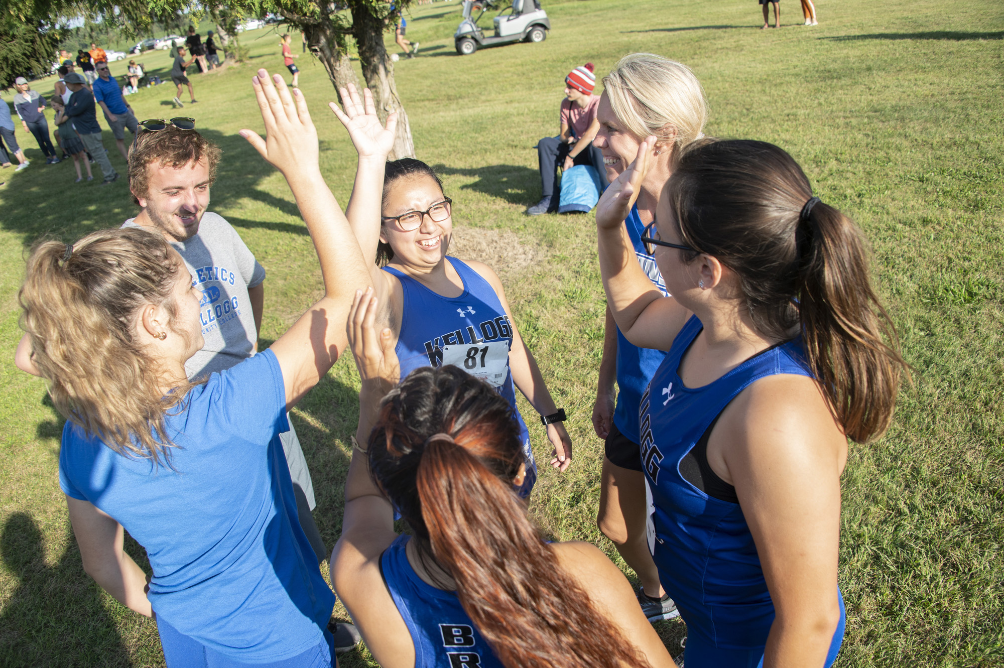 The women's cross-country team huddles before a race.