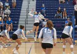 KCC's women's volleyball team competes during a match at home.