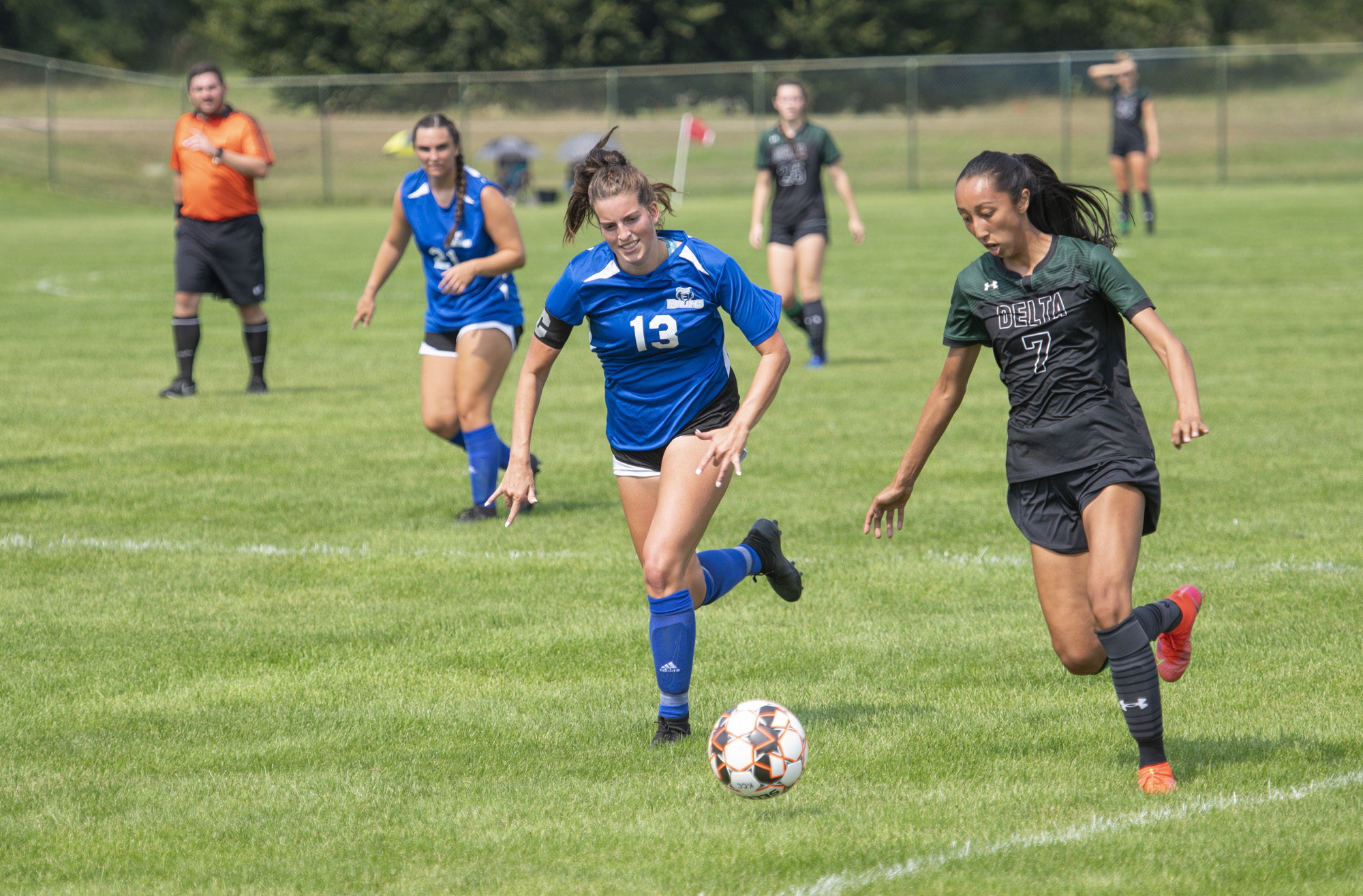 The women's soccer team competes during a home game.