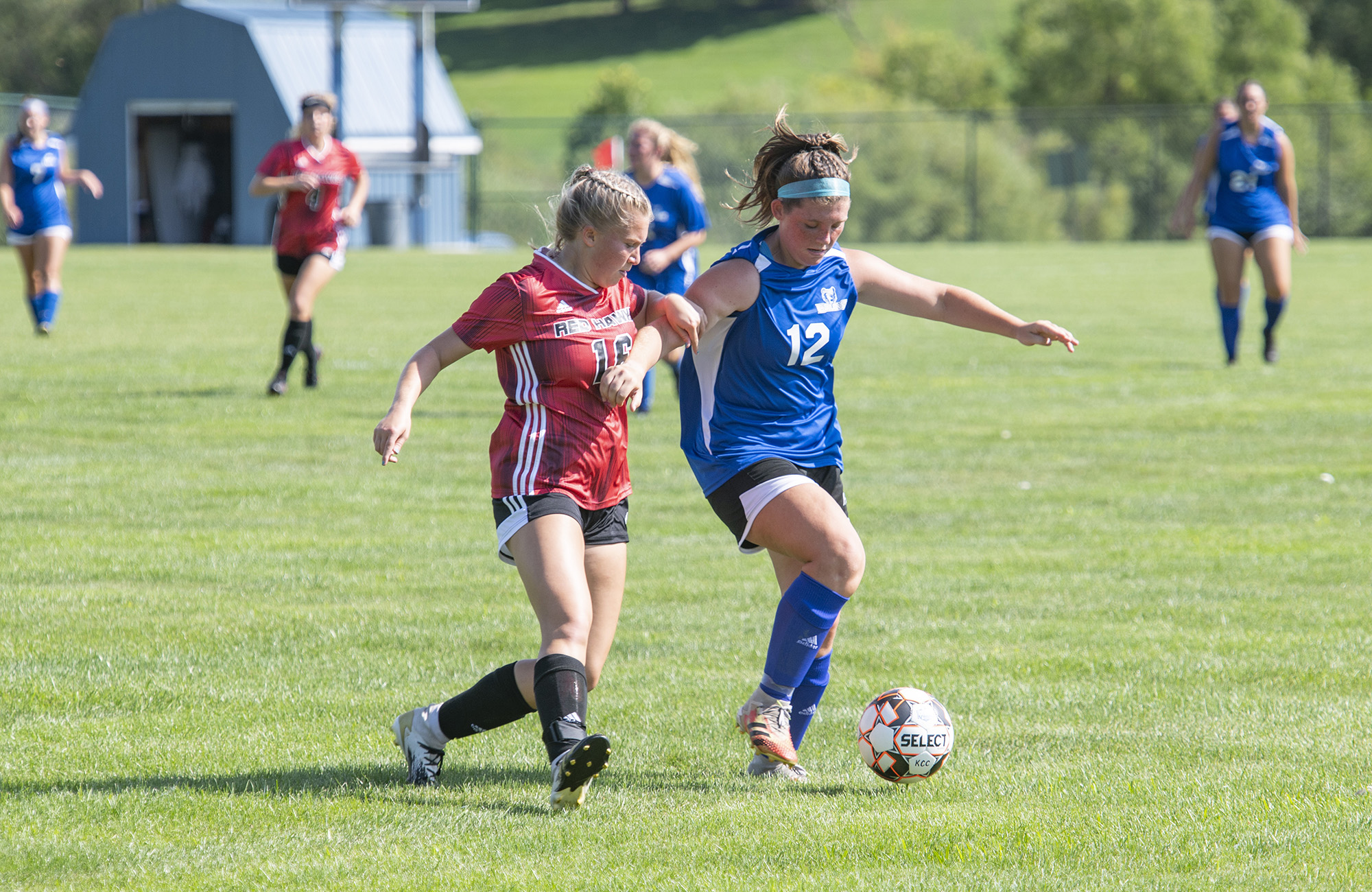Women's soccer player Chloe Leugers competes during a game.