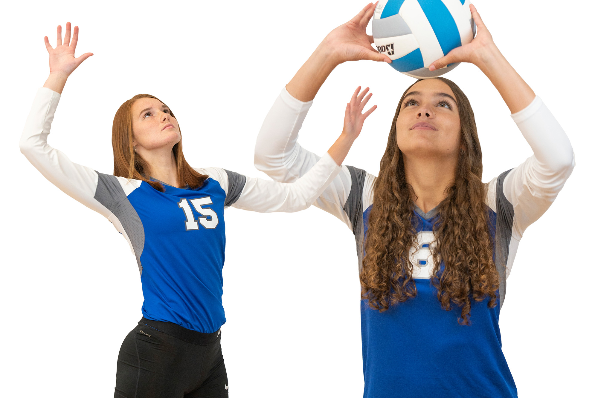 KCC volleyball players play volleyball.
