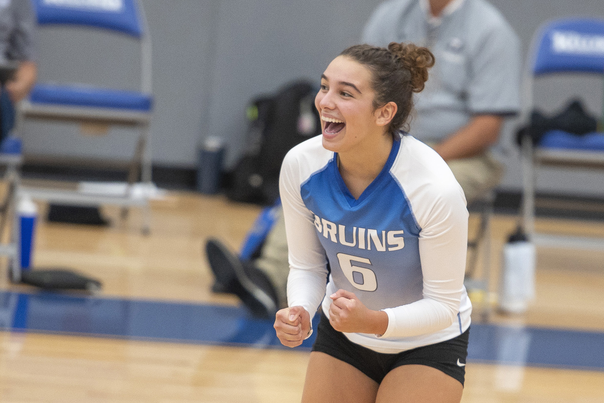 A volleyball player celebrates after scoring a point.